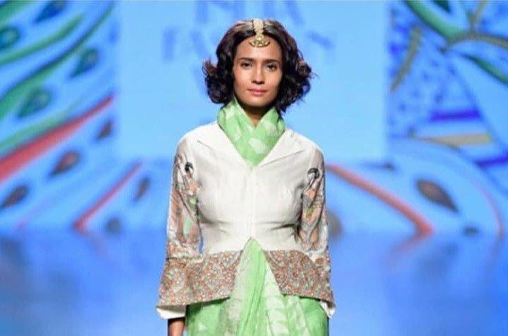 Conceptual drapes and interesting blouses on the ramp of Nirmooha by Prreeti Jaiin Nainutia at Lotus India Fashion Week 2018
